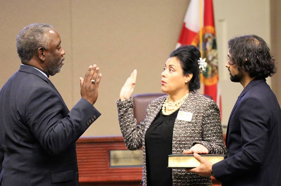 Orange County Mayor Jerry L. Demings (left) swears in Florida's Orange Soil & Water Conservation District Supervisor Daisy Morales, who was re-elected to another four year term. Photo by Willie David / Florida National News