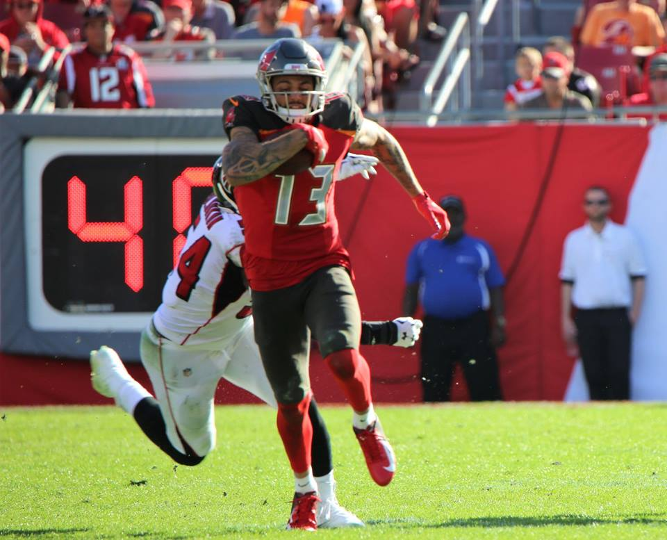 Tampa Bay Buccaneers wide receiver Mike Evans (#13) runs for the end zone against the Atlanta Falcons at Raymond James Stadium Sunday, December 30, 2018. Photo: Willie David/Florida National News.