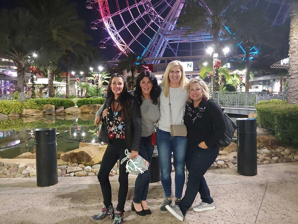 The four friends outside of the Orlando Eye (left to right: Catherine Cobb, Joanne Zappala, Michele Nunnelley, Trish Schultz)