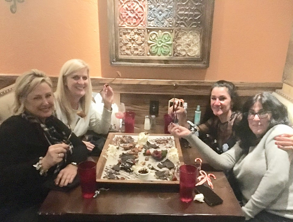 The four friends enjoy a wrap-up dinner together. (l-r) Trish Schultz, Michele Nunnelley, Catherine Cobb and Joanne Zappala