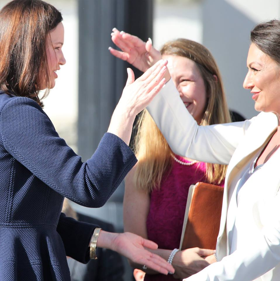 Attorney General Ashley Moody (left) and Commissioner of Agriculture Nikki Fried salute each other with a gator clap after they're sworn in during the 2019 inauguration at the Florida Capitol January 8, 2019. Photo: Mellissa Thomas/Florida National News.