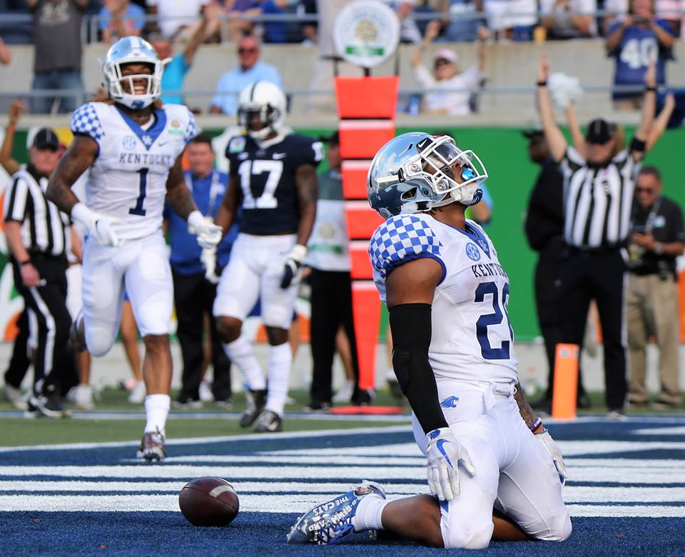 University of Kentucky Wildcats running back Benny Snell Jr. drops in awe in the end zone after getting his record-setting touchdown in the third quarter during the 2019 VRBO Citrus Bowl at Camping World Stadium on January 1, 2019. Photo: Willie David/Florida National News.