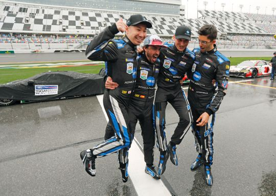 Drivers from the Konica Minolta Cadillac team (from left): Kamui Kobayashi, Fernando Alonso, Renger Van Der Zande and Jordan Taylor celebrate after winning the 2019 Rolex 24 at Daytona. Photo: Terry Renna/AP.