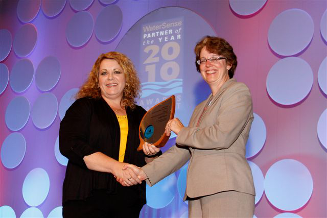 Judith Benson receives the EPA's WaterSense Partner of the Year Award in Las Vegas in October 2010. Photo courtesy of Judith Benson.