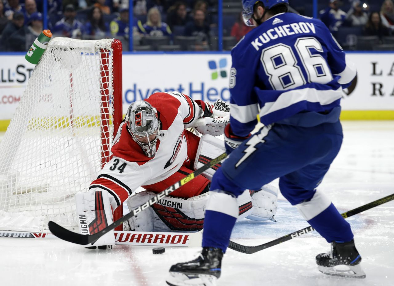 Carolina Hurricanes goaltender Petr Mrazek (34) makes a save on a shot by Tampa Bay Lightning right wing Nikita Kucherov (86) during the second period of an NHL hockey game Thursday, Jan. 10, 2019, in Tampa, Fla. (AP Photo/Chris O'Meara)