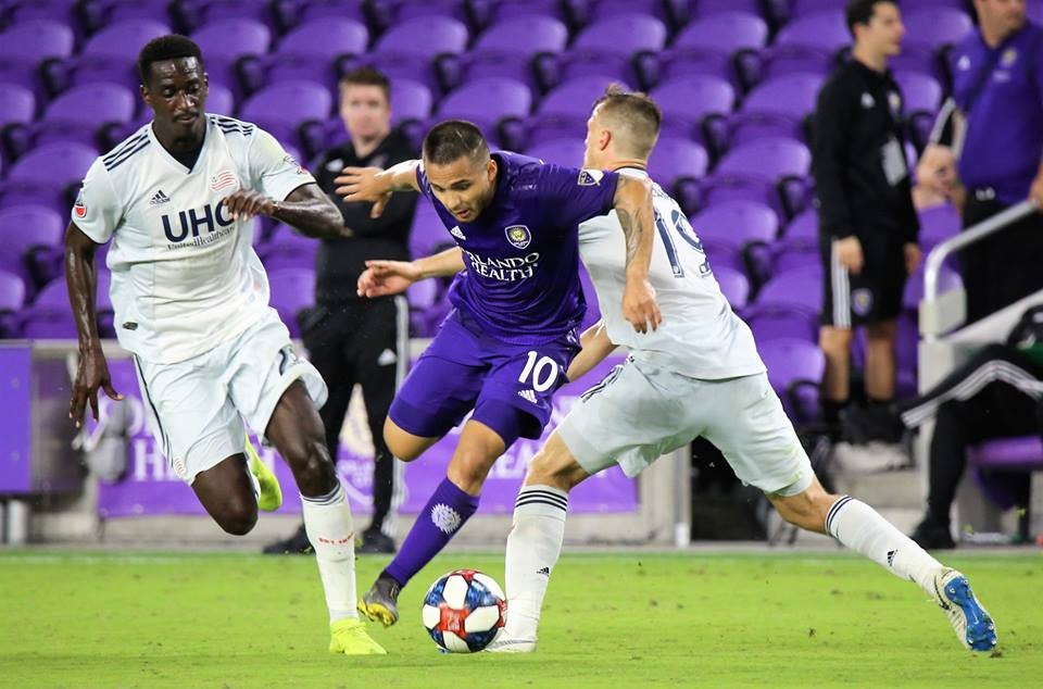 Orlando City Lions midfielder Josue Colman (#10) fights through New England Revolution's defense during the final match in the inaugural Orlando City Invitational tournament at Orlando City Stadium Wednesday, February 20, 2019. Photo: Willie David/Florida National News.