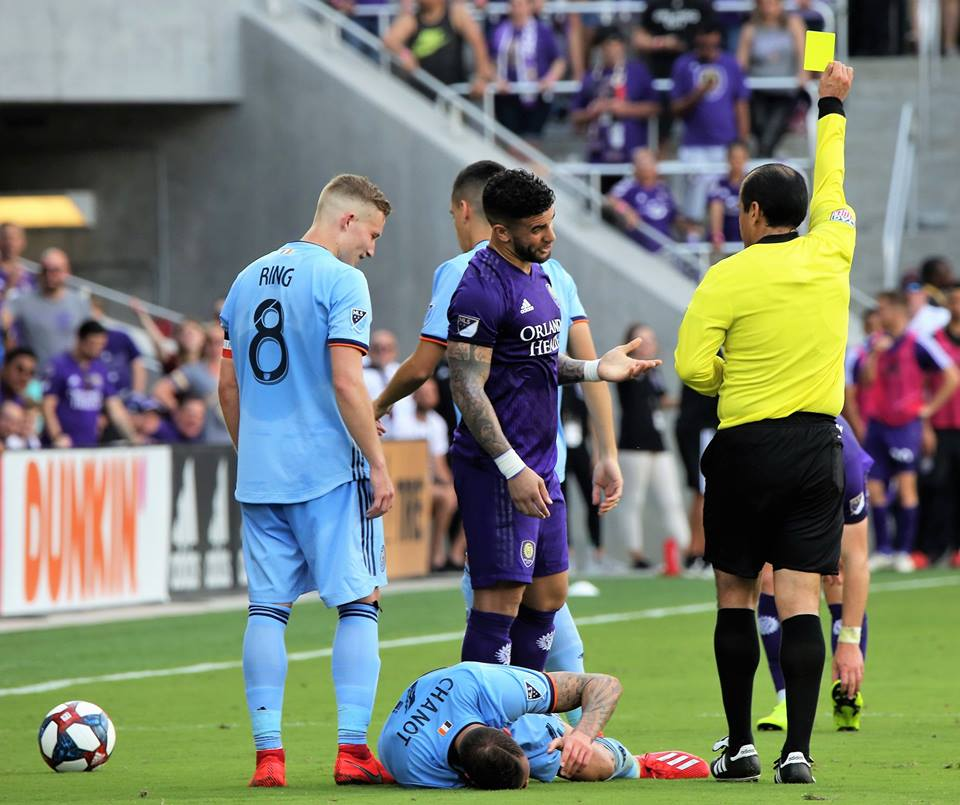 Orlando City's Dom Dwyer gets a yellow card after tumbling on NYCFC's Maxime Chanot during the MLS season opener at Orlando City Stadium Saturday, March 2, 2019. Photo: Willie David/Florida National News.