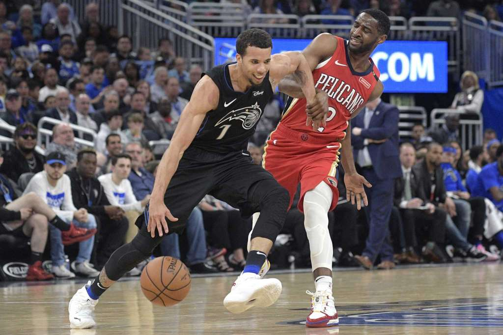 Orlando Magic guard Michael Carter-Williams (7) is fouled by New Orleans Pelicans guard Ian Clark (2) while pushing the ball up the court during the second half at Amway Center Wednesday, March 20, 2019. Photo: Phelan M. Ebenhack/AP.