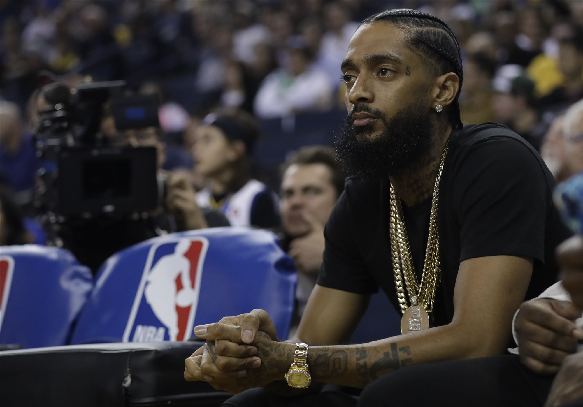 The rapper Nipsey Hussle at courtside for a game between the Golden State Warriors and the Milwaukee Bucks on in Oakland, California, in March 2018. Photo: Marcio Jose Sanchez/AP.