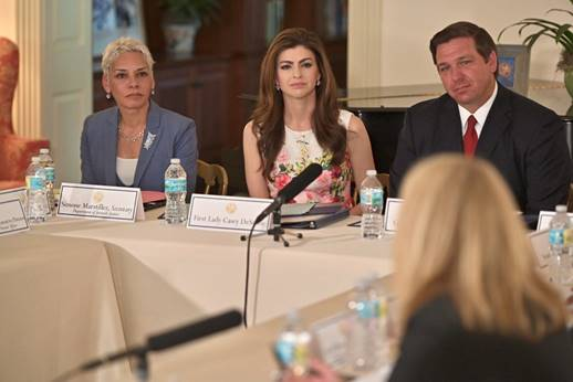 FILE - Florida First Lady Casey DeSantis (center) and Governor Ron DeSantis at a roundtable in 2019. Photo: The Governor's Office.