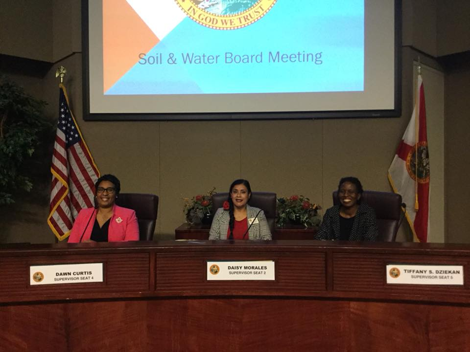 The women on the Orange Soil & Water Conservation District Board of Supervisors (l-r): Supervisor Board Vice Chair Dawn Curtis (Seat 4), Supervisor and Board Chair Daisy Morales (Seat 2), and Supervisor Tiffany Dziekan (Seat 5). The fourth woman (and third African American woman) on the Board is Supervisor Nicole McLaren (not pictured). Photo: Willie David/Florida National News.