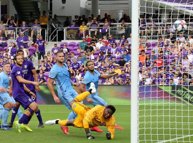 Orlando City's Tesho Akindele (#13) kicks in his first season goal as a Lion during the MLS season opener against NYCFC at Orlando City Stadium Saturday, March 2, 2019. Photo: Willie David/Florida National News.