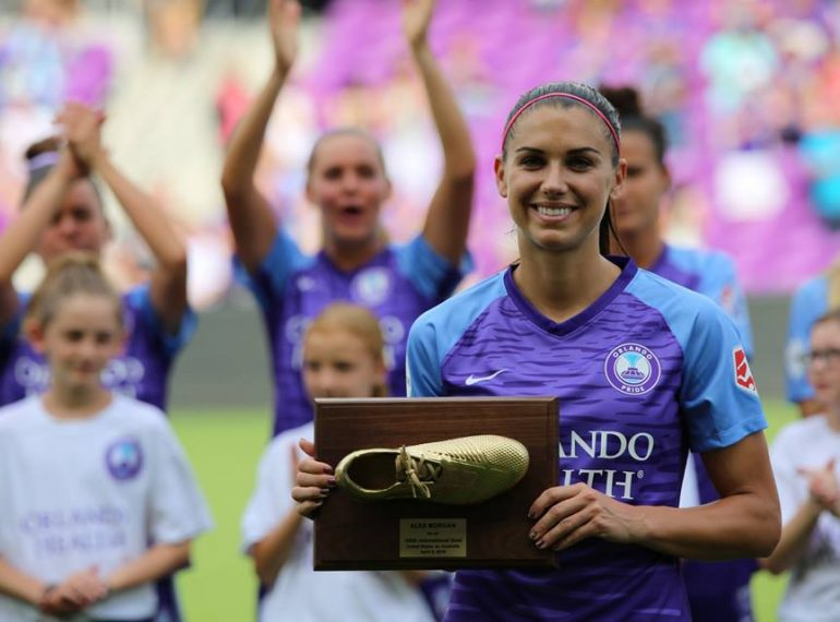 FILE - Orlando Pride forward Alex Morgan get recognized for just before kickoff at the Orlando Pride 2019 season home opener at Orlando City Stadium Sunday, April 14, 2019. File Photo: Willie David/Florida National News.