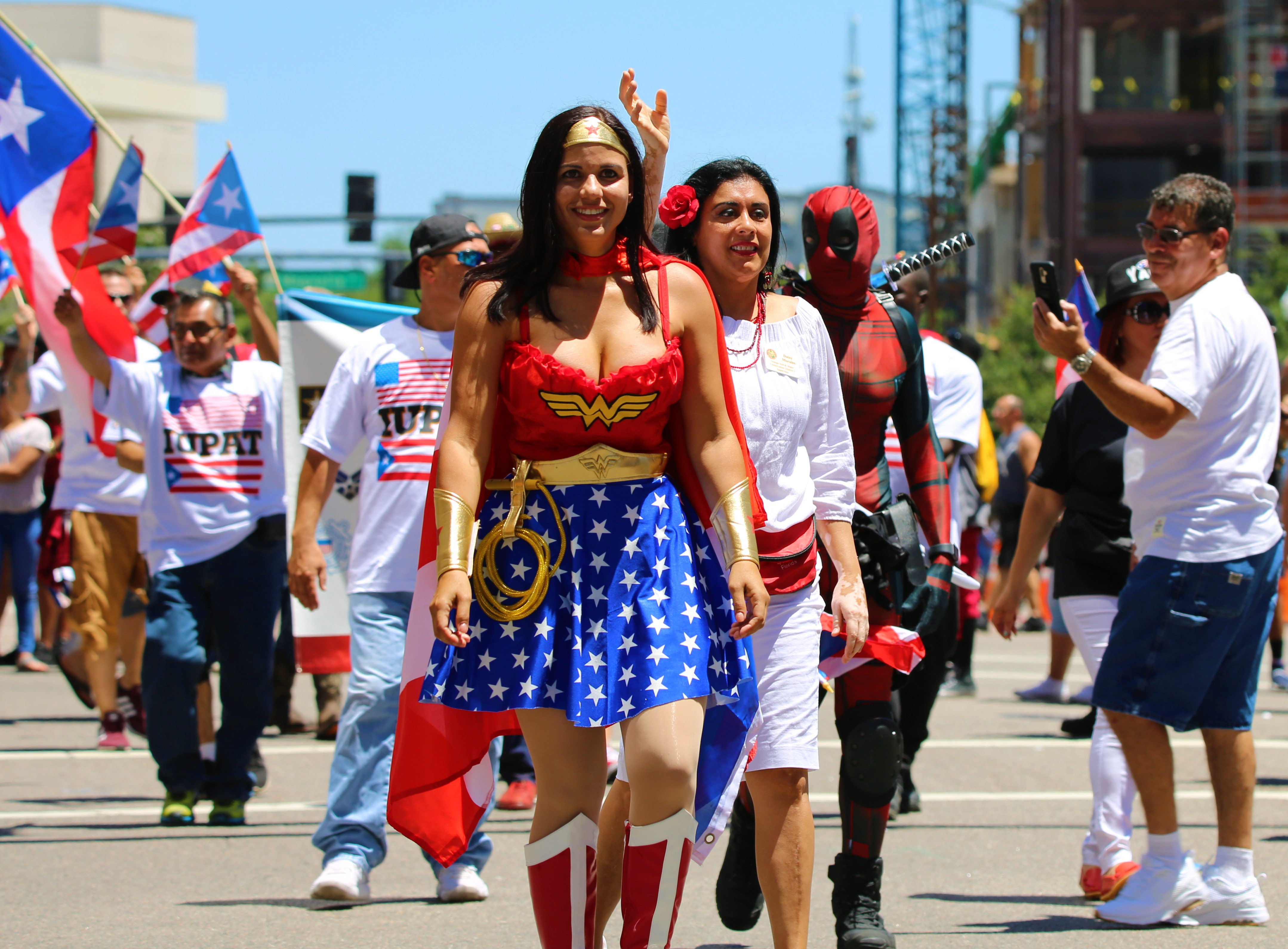 Wonder Woman (foreground) and Deadpool (background) joined Orange Soil & Water Conservation District Supervisor Daisy Morales for the 3rd annual Florida Puerto Rican Parade Saturday. Photo: Willie David/Florida National News.