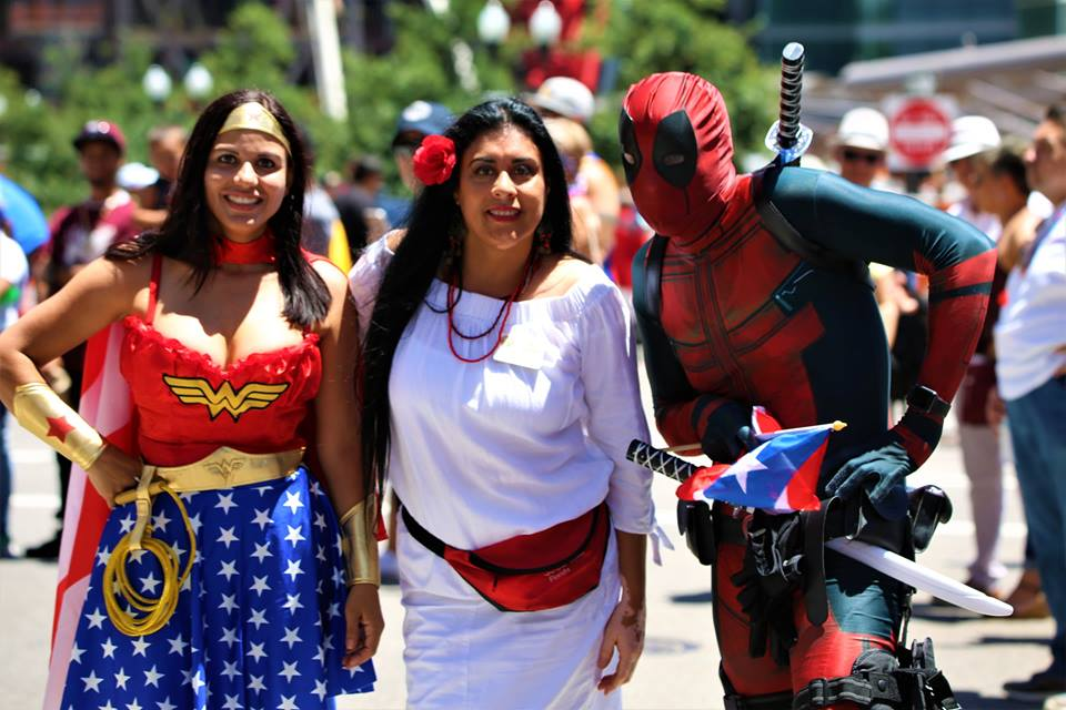 Wonder Woman and Deadpool joined Supervisor Daisy Morales (center) for Saturday's 3rd annual Puerto Rican Day Parade. Photo: Willie David/Florida National News.