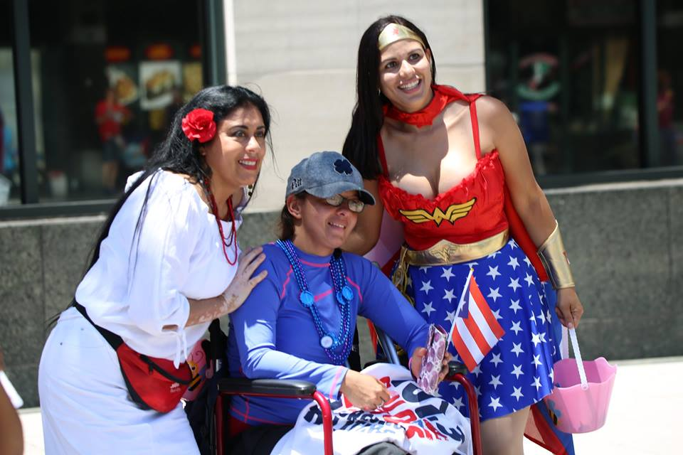 Supervisor Daisy Morales, who is also a member of the Orange County Disability Board, made sure special needs constituents got photos with the heroes as well. Photo: Willie David/Florida National News.