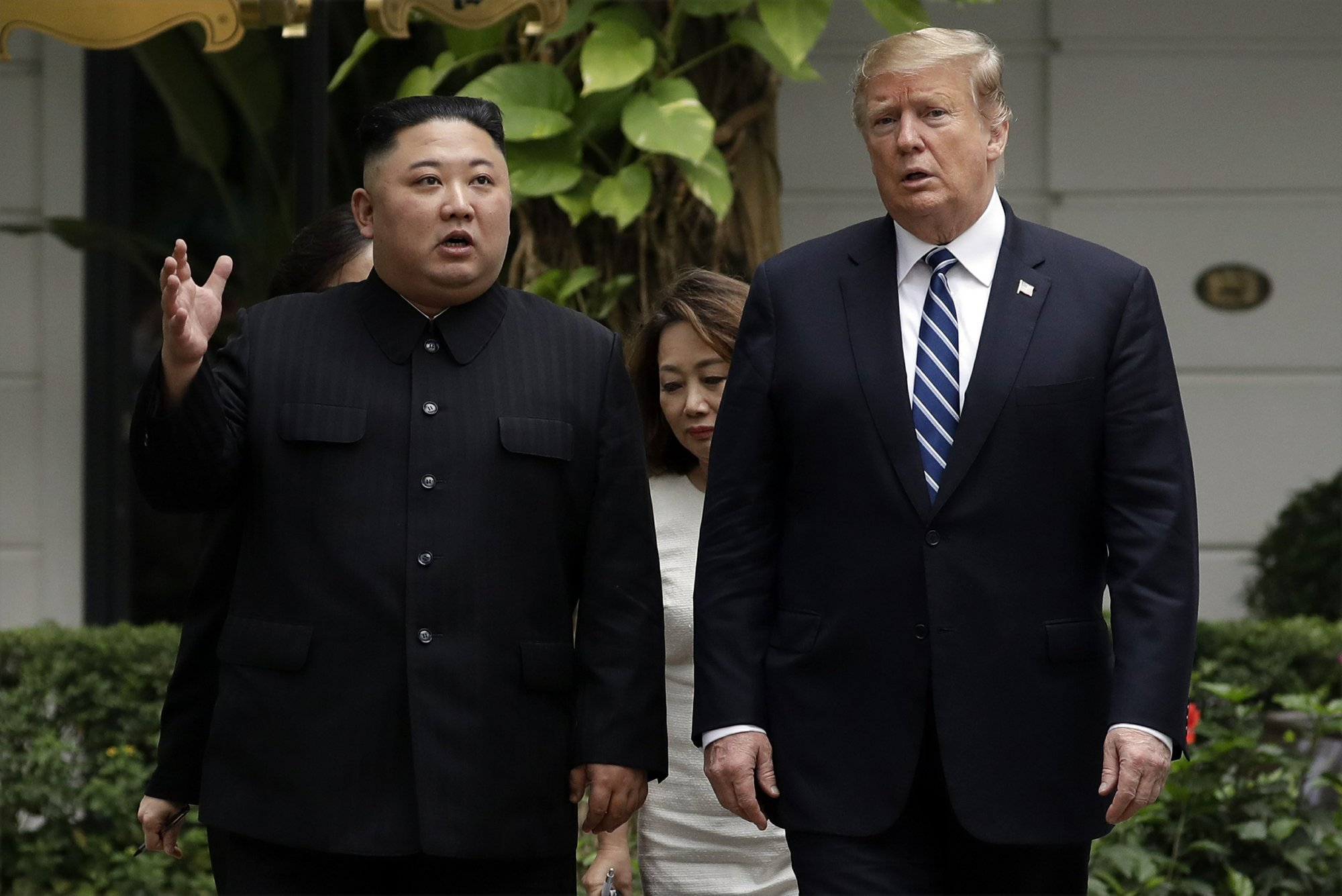 In this Thursday, Feb. 28, 2019, file photo, President Donald Trump and North Korean leader Kim Jong Un take a walk after their first meeting at the Sofitel Legend Metropole Hanoi hotel, in Hanoi. Kim says he's open to having a third summit with Trump if the United States could offer mutually-acceptable terms for an agreement by the end of the year. (AP Photo/Evan Vucci)