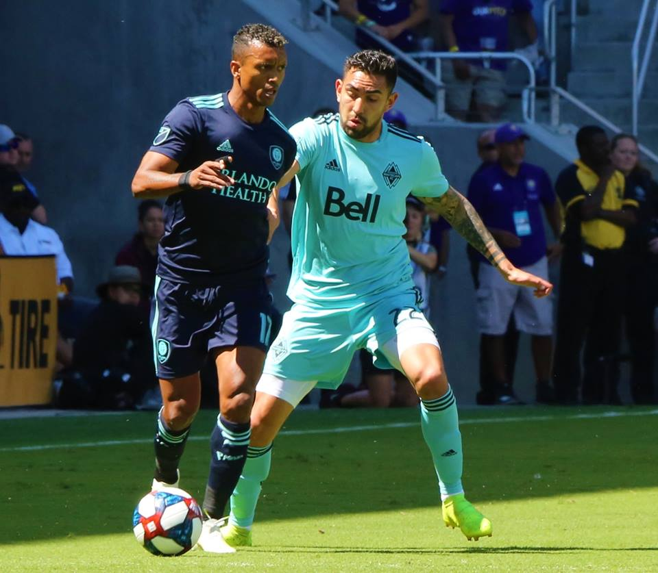 Orlando City's Luis Nani (left) duels with Vancouver's Erik Godoy for the ball at Orlando City Stadium Saturday, April 20, 2019. Photo: Willie David/Florida National News.