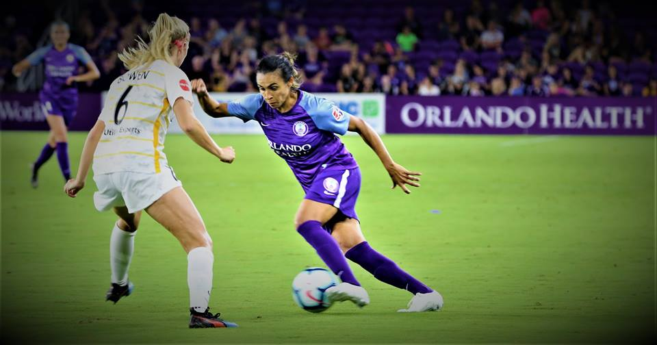 Orlando Pride's Marta (#10) presses the ball forward against Utah's Katie Bowen at Orlando City Stadium Saturday. Photo: Willie David/Florida National News.