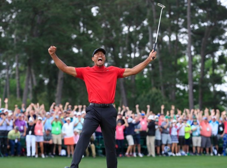 Tiger Woods celebrates his 5th Masters win after sinking the final bogie Sunday. Photo: Tannen Maury/EPA-EFE/Rex/Shutterstock
