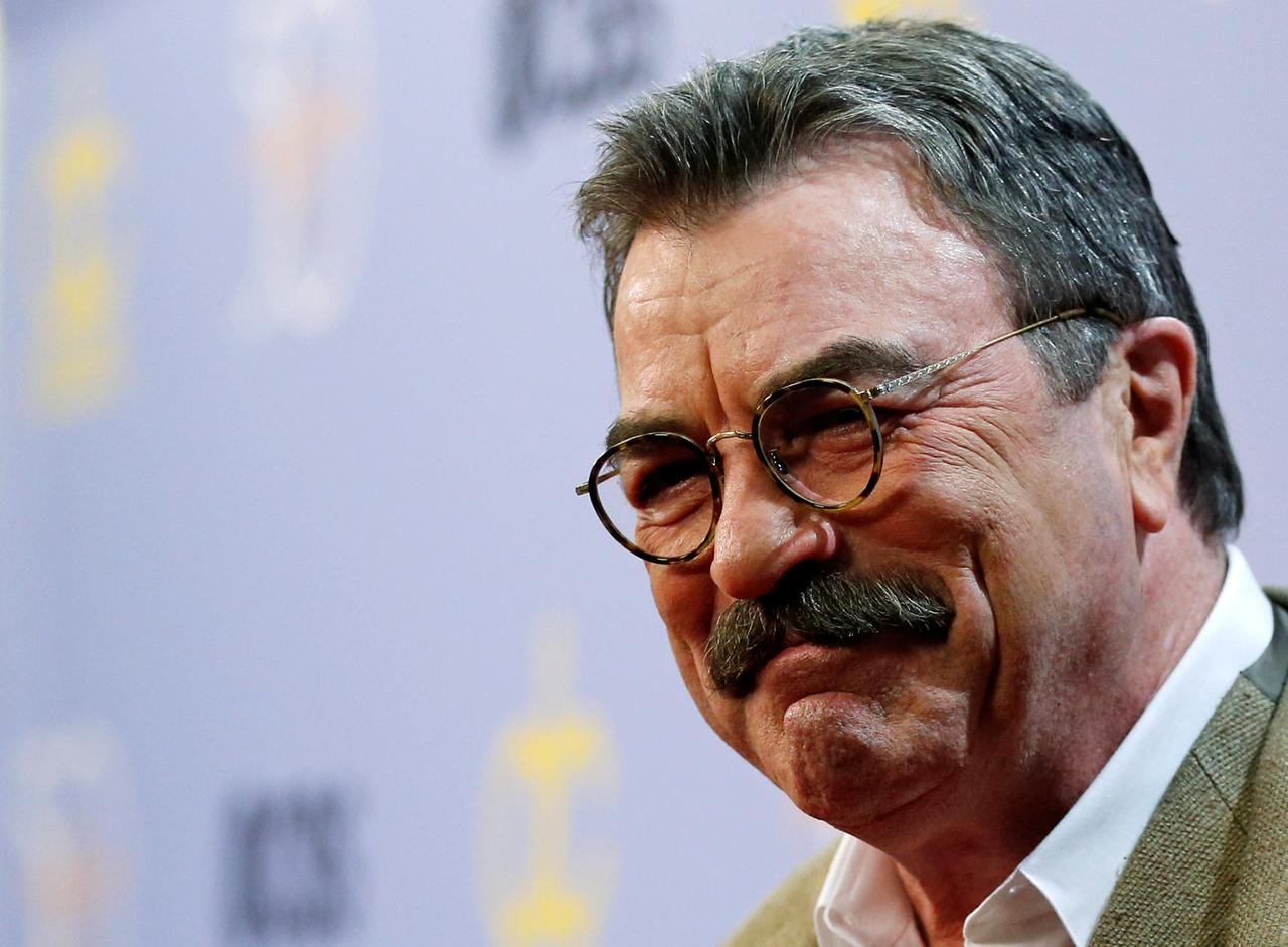 "Actor Tom Selleck poses as after arriving for the taping of ""The Carol Burnett 50th Anniversary Special"" at CBS Studios in Los Angeles, California, U.S., October 4, 2017. REUTERS/Mario Anzuoni/File Photo"