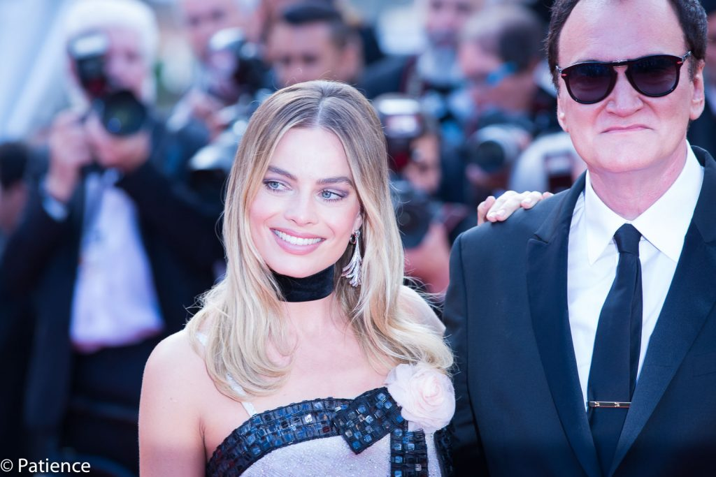 """Once Upon a Time ... in Hollywood"" star Margot Robbie shone in a Chanel baby doll top and shimmering pants alongside director Quentin Tarantino. Photo: Patience Eding/Another Concept Magazine/Florida National News."