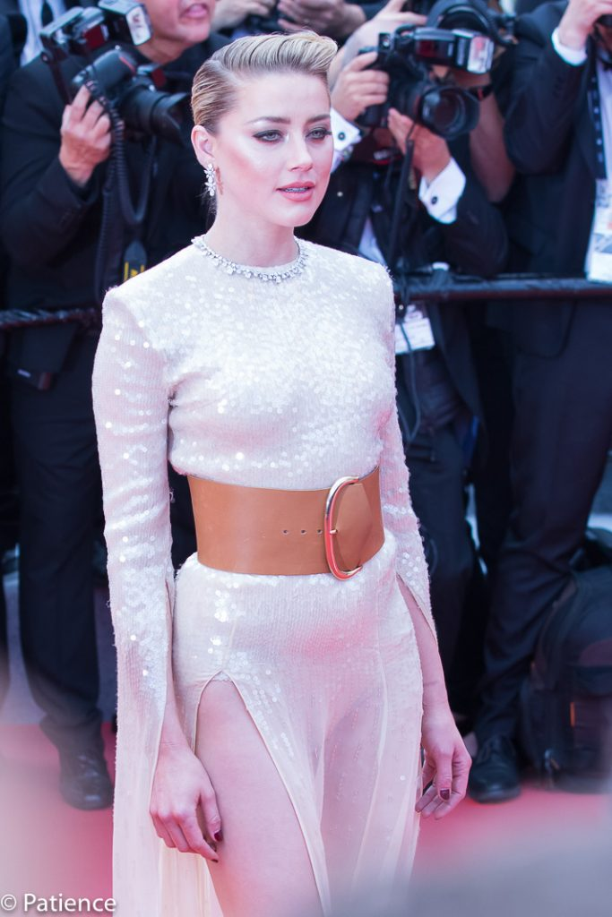 "Actress Amber Heard shone in a Claes Iversen long-sleeve column dress and accessorized with spiky Christian Louboutin pumps and a chunky belt on the red carpet for the premiere of ""Les Miserables"" at the 2019 Cannes Film Festival Wednesday. Photo: Patience Eding/Another Concept Magazine/Florida National News."
