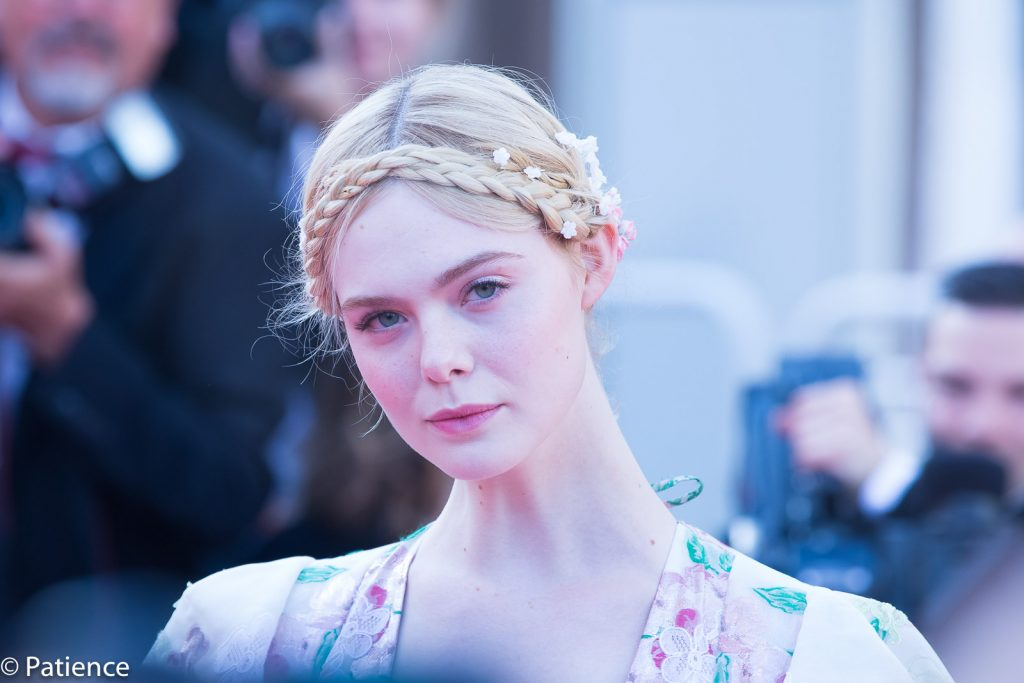 2019 Cannes Film Festival Jurist Elle Fanning was an absolute belle in her floral Valentino ballgown with plunging neckline--but the true statement was her hair, which embodied the fresh vibrance and playfulness of summer. Photo: Patience Eding/Another Concept Magazine/Florida National News.