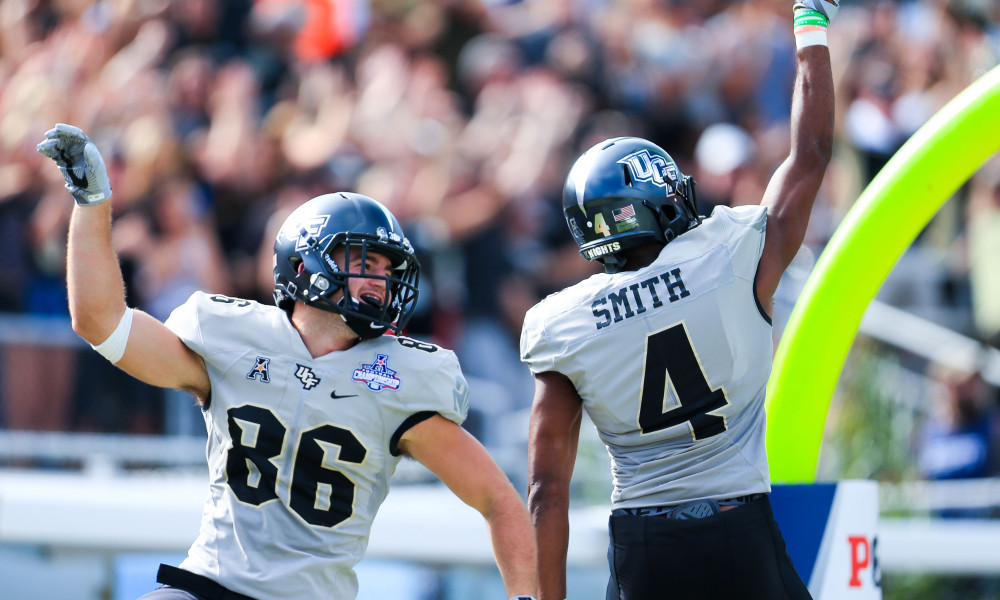 In this photo, UCF Knights tight end Michael Colubiale (86)--newly signed to the Jacksonville Jaguars--celebrates with wide receiver Tre'Quan Smith (4) after Smith scored a touchdown against the Memphis Tigers at Spectrum Stadium in Orlando. Photo: Matt Stamey-USA TODAY Sports
