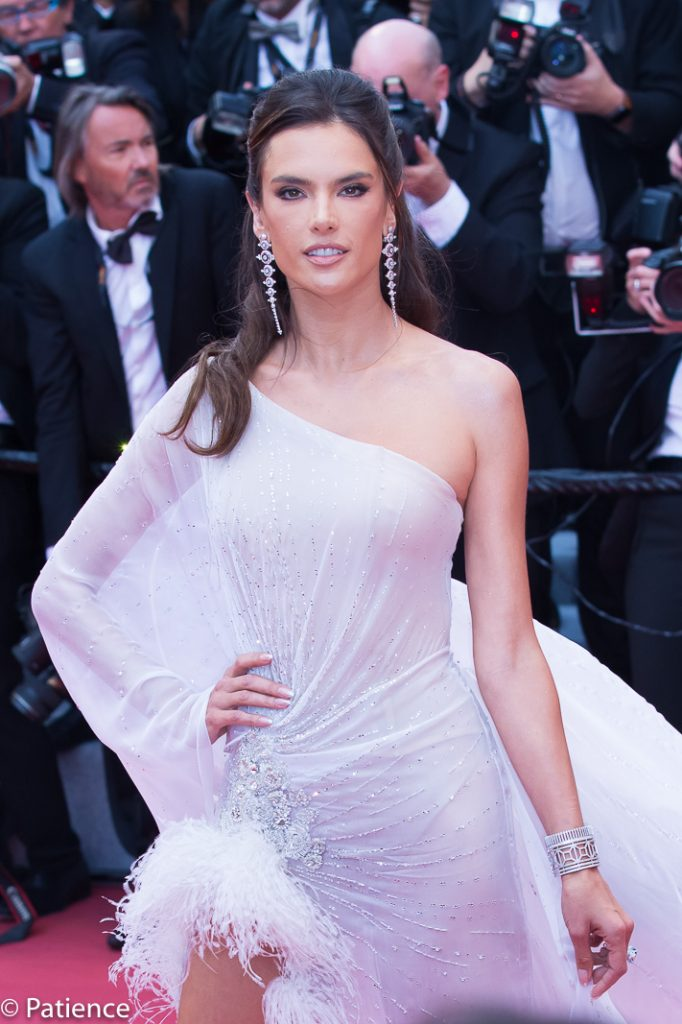 Supermodel Alessandra Ambrosio stunned in this feather-adorned sheer asymmetrical Ralph & Russo gown and Rene Caovilla sandals. Photo: Patience Eding/Another Concept Magazine.