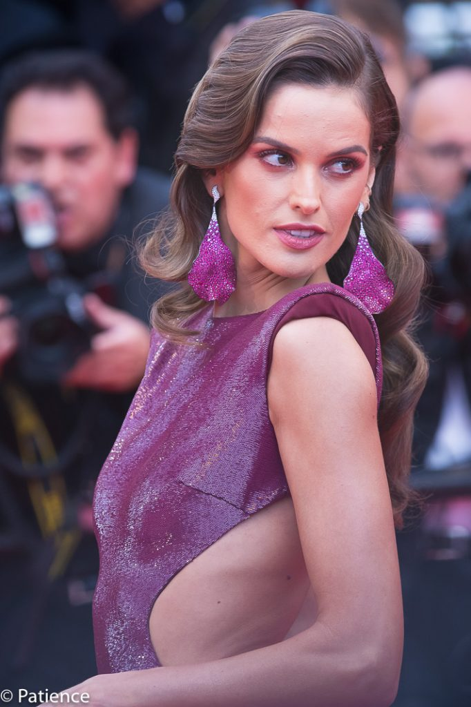 """Supermodel Izabel Goulart lit the Cannes red carpet afire in this sequined raspberry cut-out Etro number and Chopard jewelry as she attended the Opening Night film premiere of """"Dead People Don't Die."""" Photo: Patience Eding/Another Concept Magazine."""