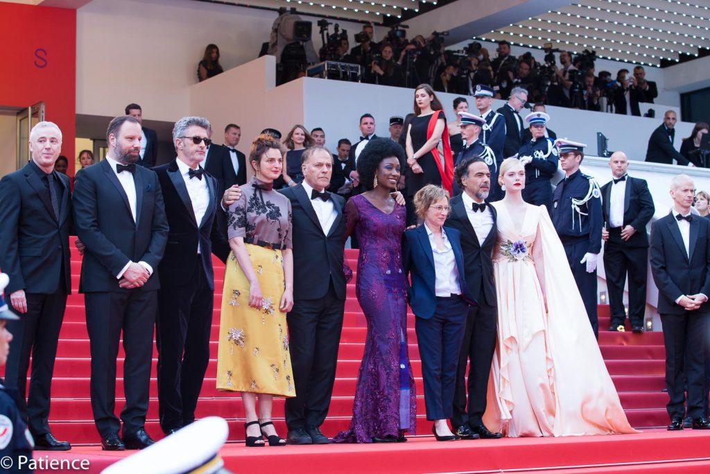 The 2019 Cannes Film Festival Jury (l-r): Robin Campillo, Yorgos Lanthimos, Pawel Pawlikowski, Alice Rohrwacher, Enki Bilal, Maimouna N'Diaye, Kelly Reichardt, Alejandro Gonzalez Inarritu, Elle Fanning. Photo: Patience Eding/Another Concept Magazine.