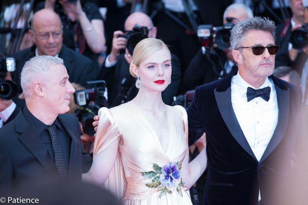 Actress and 2019 Cannes Film Festival Jury member Elle Fanning (center) wowed in flowing Gucci and Chopard jewels on the Opening Night red carpet. Photo: Patience Eding/Another Concept Magazine.