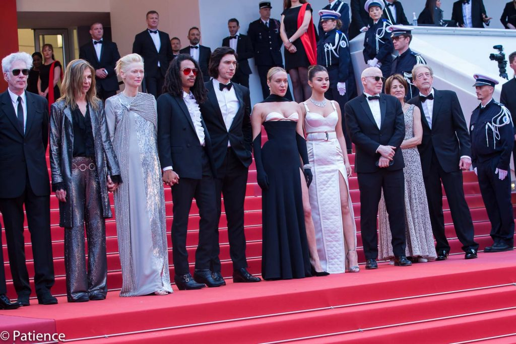 """""""The Dead Don't Die"""" cast and crew (l-r): Sarah Driver, Tilda Swinton, Luka Sabbat, Adam Driver, Chloe Sevigny, Selena Gomez, director Jim Jarmusch on the 2019 Cannes Film Festival Opening Night red carpet for the premiere of their film. Photo: Patience Eding/Another Concept Magazine/Florida National News."""