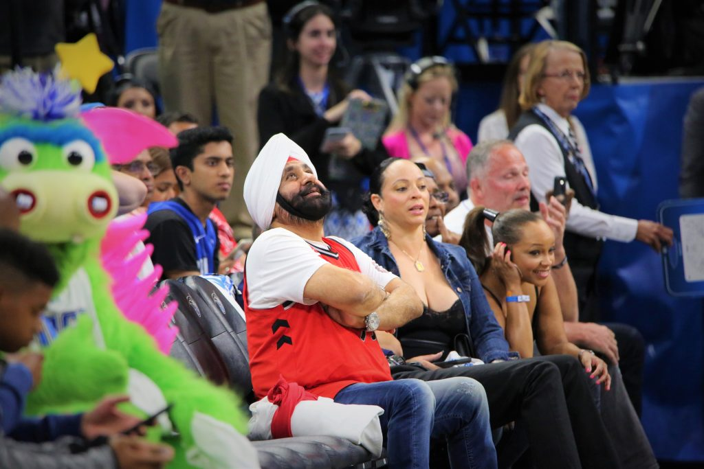 Raptors Superfan Nav Bhatia checks the Amway Center scoreboard during Round 1, Game 3 of the NBA Playoffs Friday, April 19, 2019. Photo by Willie David / Florida National News
