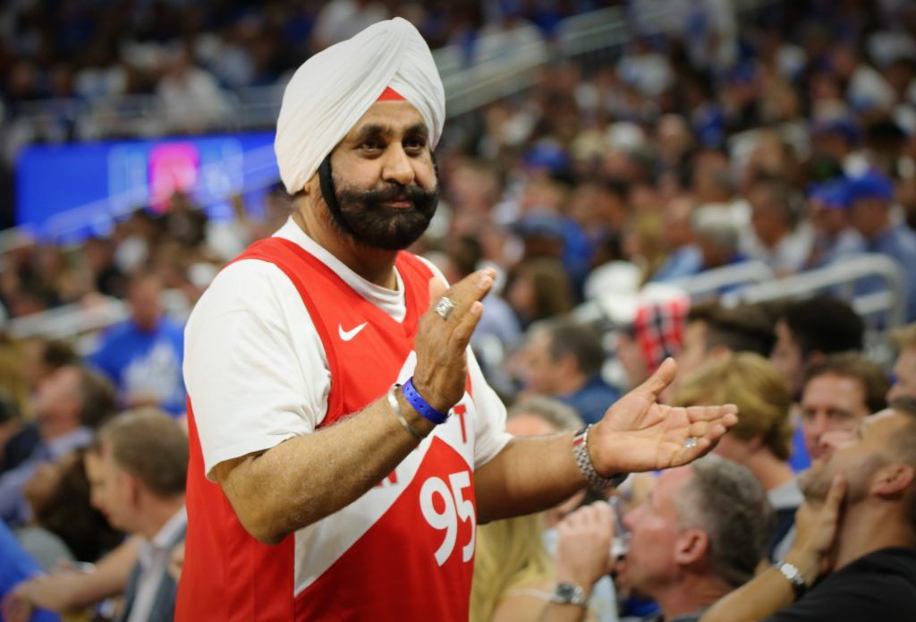 Raptors Superfan Nav Bhatia put the spotlight on diversity and inclusion on the NBA sidelines at Amway Center when the Toronto Raptors faced the Orlando Magic in Round 1, Game 3 of the Playoffs Friday, April 19, 2019. Photo by Willie David / Florida National News