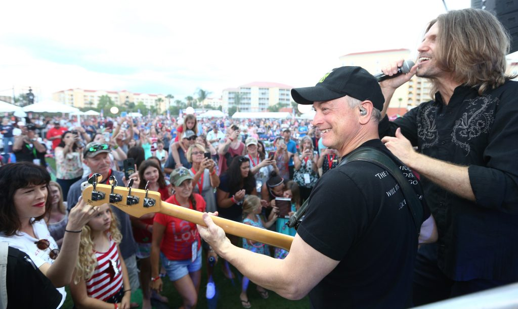 Actor Gary Sinise (foreground, ball cap) and the Lt. Dan Band entertain the crowd at Westgate Vacation Villas & Town Center Resort during Westgate Resorts' Military Weekend. (Scott Iskowitz/AP Images for Westgate Resorts)