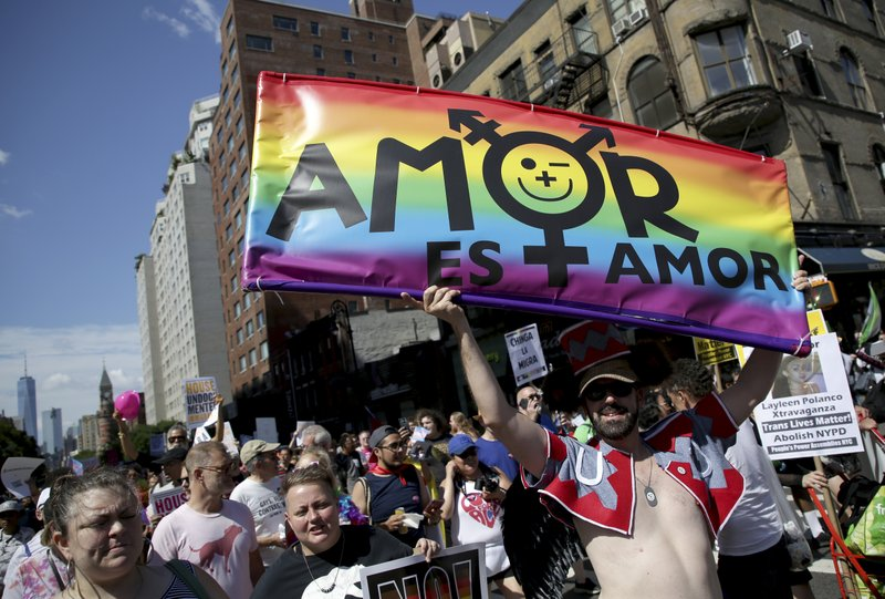 FILE - Marchers participate in the Queer Liberation March in New York, Sunday, June 30, 2019. New York is throwing a massive LGBTQ Pride march as other cities including San Francisco, Chicago and Seattle also host parades commemorating the 50th anniversary of the clash between police and gay bar patrons that sparked the modern gay rights movement. The organizers of the smaller Queer Liberation March say the larger Pride event has become too commercialized and too heavily policed. (AP File Photo/Seth Wenig)