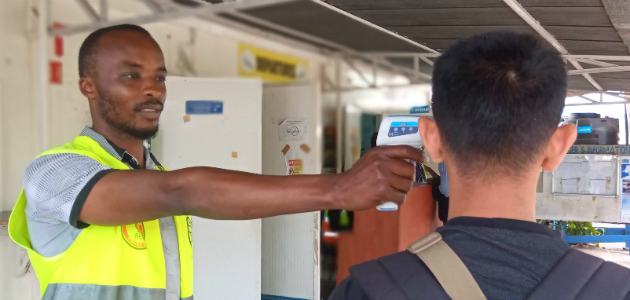 The first step in Goma International Airport's ebola screening is a temperature check. Photo: Tania Seburyamo.