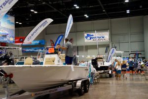 More guests walk the North Concourse convention hall to take in boats of all shapes, sizes and styles. Photo: Leyton Blackwell/Florida National News.