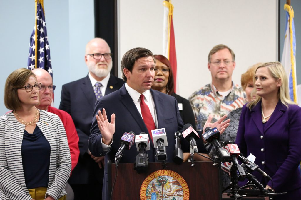 FILE - Florida Governor Ron DeSantis was joined by Secretary of State Laurel M. Lee, Florida State Association of Supervisors of Elections President Tammy Jones and Florida's Election Supervisors to announce Florida would join 29 States in Enhancing Voter Registration in Orlando, Wednesday, August 21, 2019. (Photo by Willie David / Florida National News, FNN News Network)