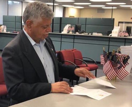 Khalid Muneer completes his paperwork to run for Orange County Property Appraiser at the Orange County Supervisor of Elections Office Monday afternoon. Photo courtesy of Khalid Muneer.