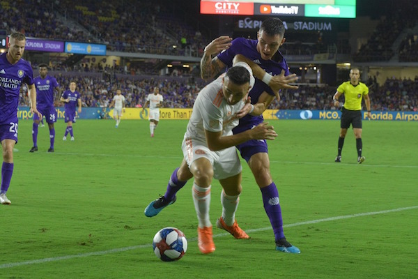 Orlando City SC's Kyle Smith and Atlanta United FC's Justin Meram, a former Orlando player, battle for the ball just left of Ortlando's goal at Exploria Stadium Friday. Photo: Clyde Lemon/Florida National News.