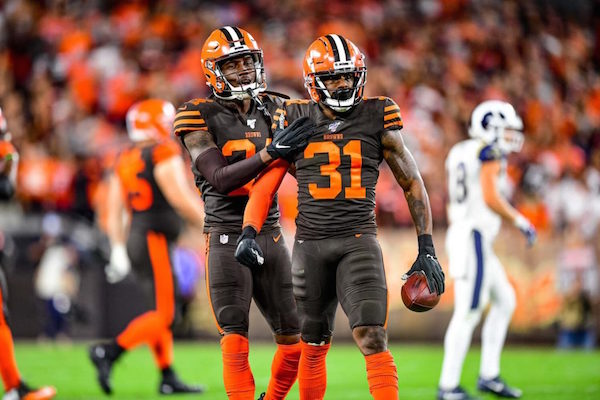 Cleveland Browns running back Nick Chubb (#24) congratulates defensive back Juston Burris (#31), who stands tall after intercepting a pass from LA Rams quarterback Jared Goff. Photo: Cleveland Browns.