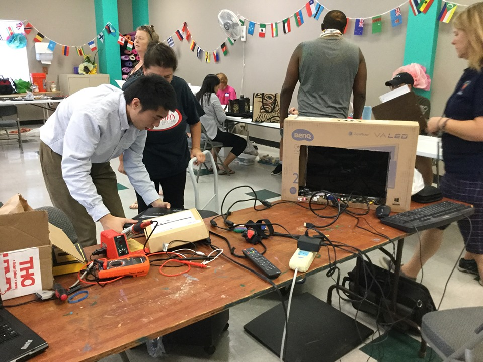 """An Orange County Environmental Protection Division volunteer repairs a gutted computer during Orange County EPD's """"Don't Pitch It, Fix It!"""" event at Blanchard YMCA Family Center Saturday, September 21, 2019. Photo: Willie David/Florida National News."""