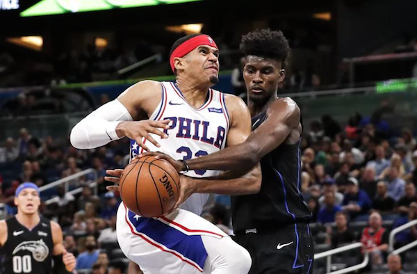 Orlando Magic's Jonathan Isaac tries to steal the ball against the Philadelphia 76ers. Photo courtesy of OrlandoMagicDaily.com.