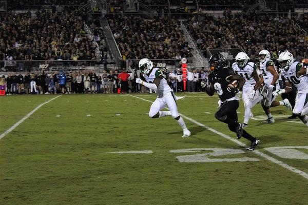 Adrian Killins makes a 115-yard touchdown run against USF at Spectrum Stadium. Photo: Michelle Alexander/Florida National News.