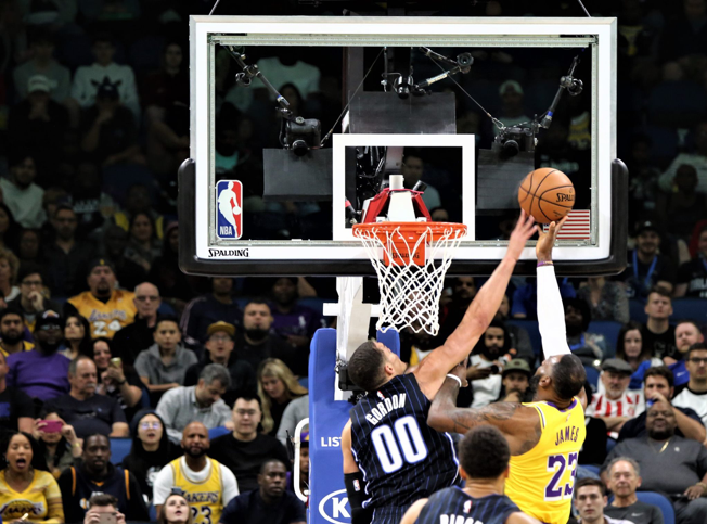 Orlando's Aaron Gordon (#00) blocks Lebron James' layup in the heated Magic vs. Lakers match at Amway Center Wednesday, December 11, 2019. Photo: Willie David/Florida National News.