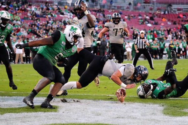 UCF Knights land a touchdown against Marshall University's Herd during the 2019 Gasparilla Bowl at Raymond James Stadium on December 23, 2019. Photo by Megan Turner/KnightNews.com.