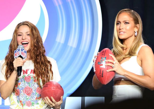 Latina legends Shakira (left) and Jennifer Lopez ready their special edition Super Bowl LIV footballs to toss them into the press audience during the Pepsi Super Bowl Halftime Show Press Conference at the Hilton Miami Downtown Thursday, January 30, 2020. Photo: Willie David/Florida National News.